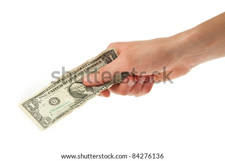 young man holding one dollar in his hand - stock photo