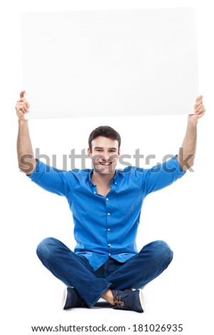 Young man holding poster above his head   - stock photo