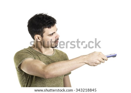 young man holding remote tv control - stock photo