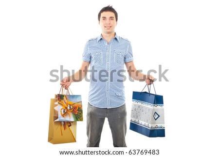 Young man holding shopping bags isolated on white background