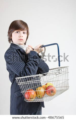 young man holding shopping basket with apples