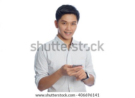young man holding smart-phone  isolated on white background - stock photo