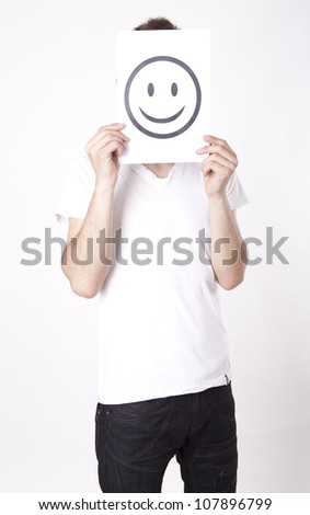 Young man holding smiley face.