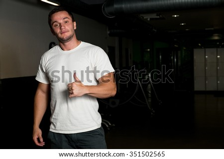 Young Man holding thumbs up