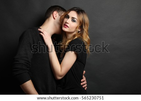 Young man hugging his girlfriend.