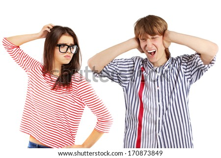 Young man ignoring girl.Arguing young couple - stock photo