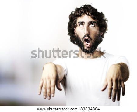 young man imitating a zombie at living room - stock photo