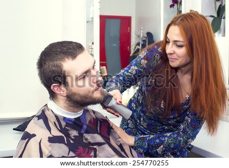 young man in a barber shaved shorn - stock photo