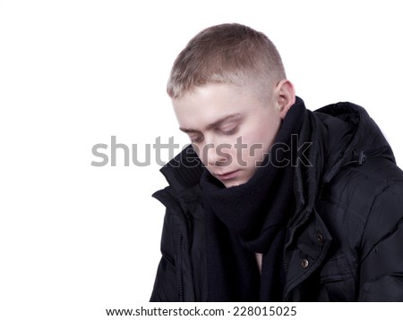 young man in a black jacket  on a white background - stock photo