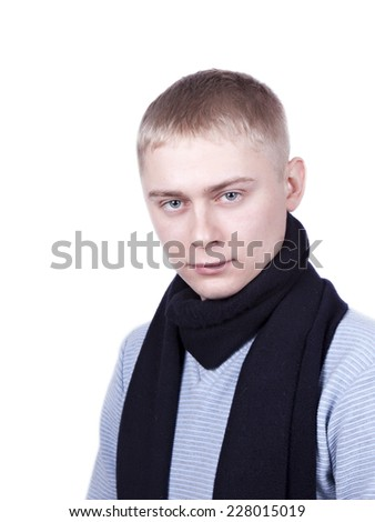 young man in a blue sweater and a black scarf on a white background - stock photo