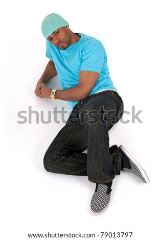 Young man in a blue t-shirt lying down thinking. Isolated on white background.