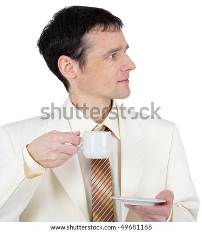 Young man in a business suit with a cup of coffee - stock photo
