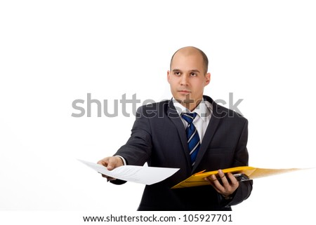 Young man in a business suit with folder and work documents in his hand - stock photo