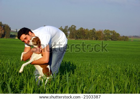 young man in a field - stock photo