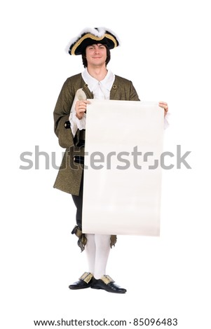 Young man in a historical costume with the blank paper in hands - stock photo