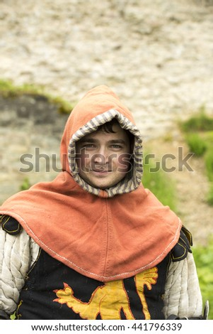 Young man in a medieval knight costume