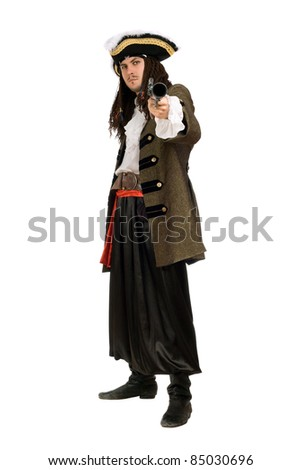 Young man in a pirate costume with pistol - stock photo