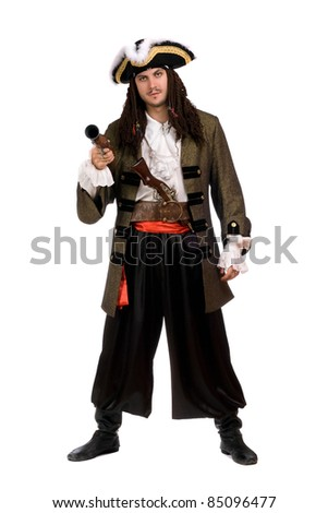 Young man in a pirate costume with pistol. Isolated