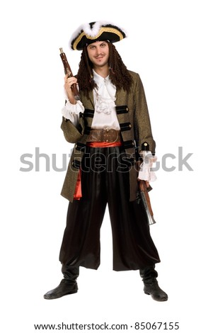 Young man in a pirate costume with pistols - stock photo