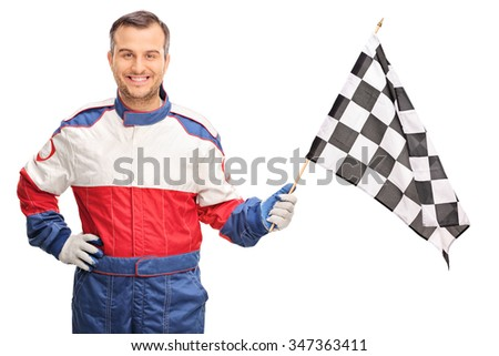 Young man in a racing suit waving a checkered race flag and looking at the camera isolated on white background - stock photo