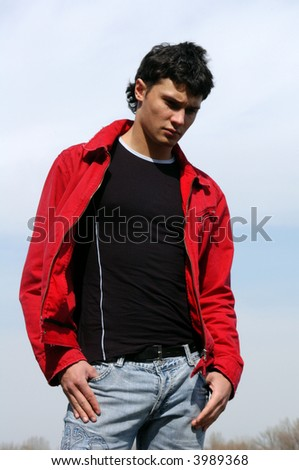 Young man in a red jacket - stock photo
