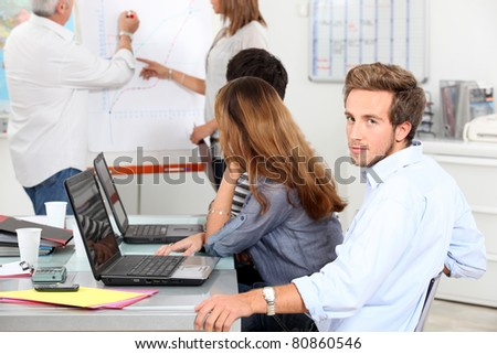 Young man in a sales briefing - stock photo