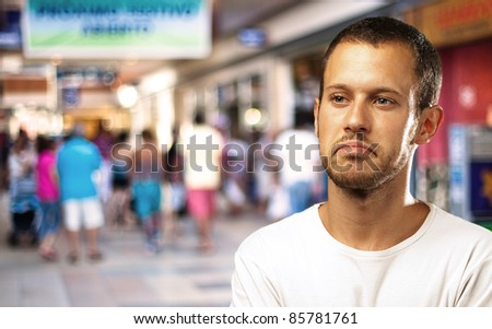 young man in a shopping center