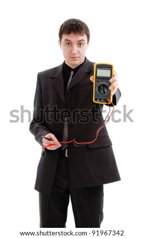 young man in a suit demonstrates a multimeter, isolated on a white background. - stock photo