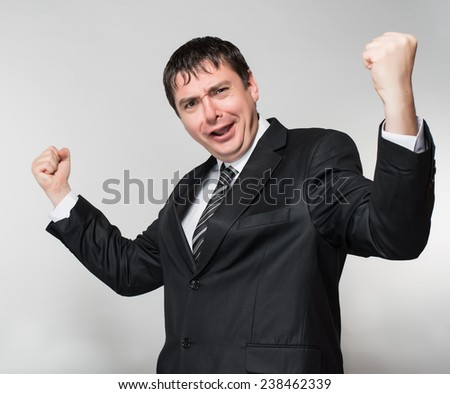 young man in a suit enjoys a successful business deal - stock photo
