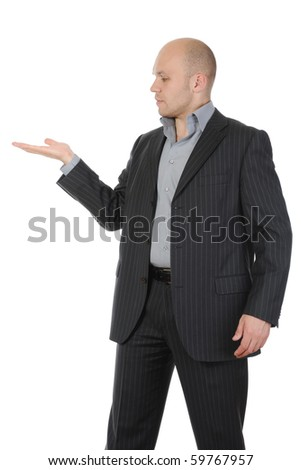 young man in a suit holds her hand, palm up. Isolated on white background - stock photo