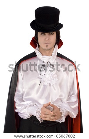Young man in a suit of Count Dracula. Isolated - stock photo