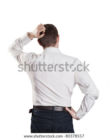 young man in a suit scratching his head in bewilderment - stock photo