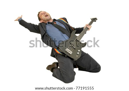 Young man in a suit with guitar - stock photo