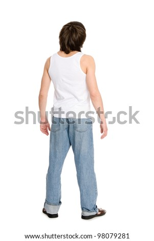 Young man in a undershirt stands with his back. - stock photo