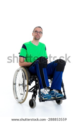 young man in a wheelchair in front of white background - stock photo