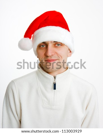 young man in a white jacket and Santa hat. portrait