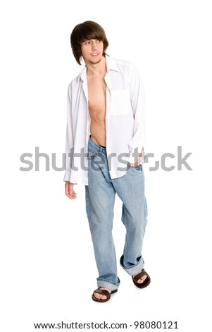 young man in a white shirt and jeans - stock photo