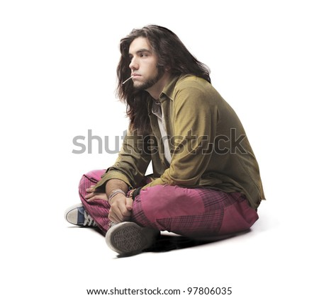 Young man in alternative clothes smoking - stock photo