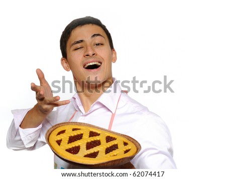 Young man in apron baked tasty pie. isolated on white background - stock photo