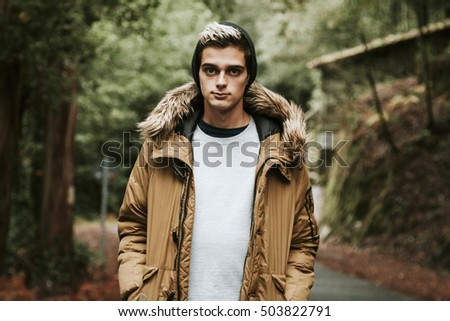 young man in autumn outdoors in the forest