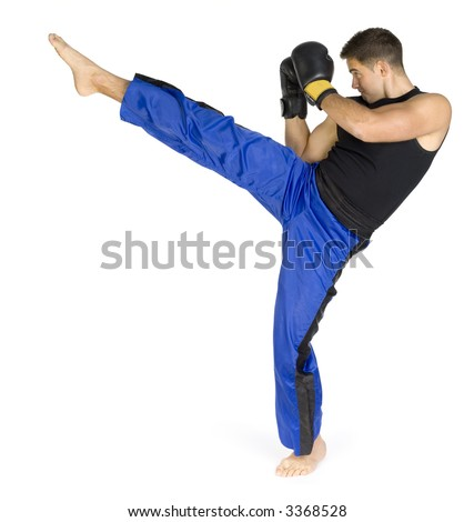 Young man in black boxing gloves doing flying kick. Isolated on white in studio. Whole body, standing backside. - stock photo
