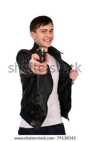 Young man in black shirt posing with gun.