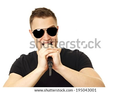 Young man in black shirt singing into the microphone - stock photo