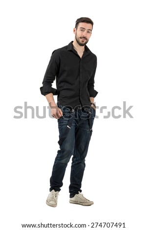 Young man in black shirt with rolled up sleeves walking. Full body length portrait isolated over white background. - stock photo