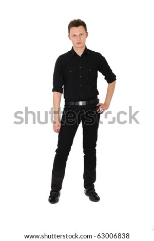 Young man in black standing on white background