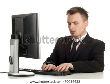 young man in black suit working on computer - stock photo