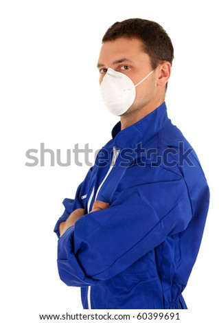 young man in blue coveralls and protective mask
