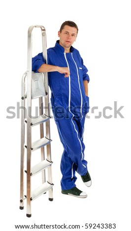 young man in blue coveralls with metal ladder - stock photo