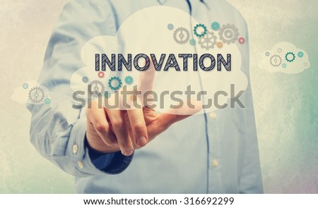 Young man in blue shirt pointing at Innovation - stock photo