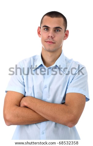 Young man in blue shirt with arms crossed isolated on white